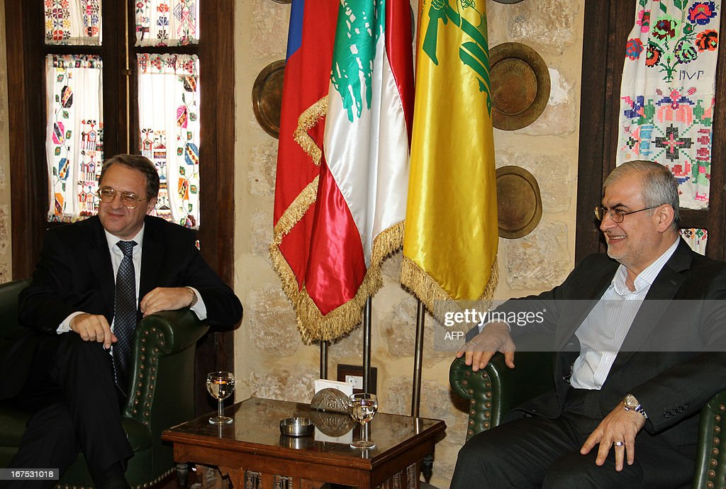 Russian special envoy and Deputy Foreign Minister Mikhail Bogdanov (L) meets with Hezbollah member of parliament Mohammad Raad in Beirut on April 26, 2013.