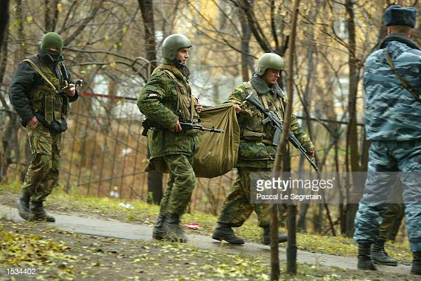 Russian special forces soldiers carry a bag near the Moscow theater where hundreds of hostages were held by Chechen rebels October 26 2002 in Moscow...