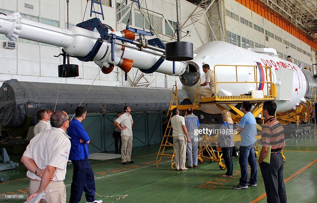 Russian specialist assemble the Soyuz-FG rocket booster with Soyuz TMA-05M spaceship for the launch of the next expedition to the International Space Station in the Russian-leased Baikonur cosmodrome, July 11, 2012. The launch of the next ISS crew including US astronaut Sunita Williams, Russian cosmonaut Yuri Malenchenko and Japanese astronaut Akihiko Hoshide is scheduled on July 15.