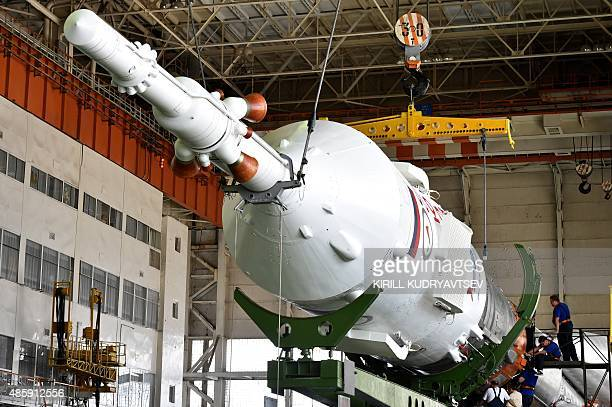Russian specialists assemble the Soyuz TMA18M spacecraft at an assembling department at the Russianleased Baikonur cosmodrome in Kazakhstan on August...