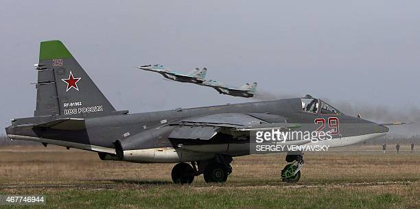 Russian SU 25 SM ground attack aircraft and MIG 29 jet fighters attend a training session at PrimorksoAkhtarsk Krasnodar region on March 26 2015...