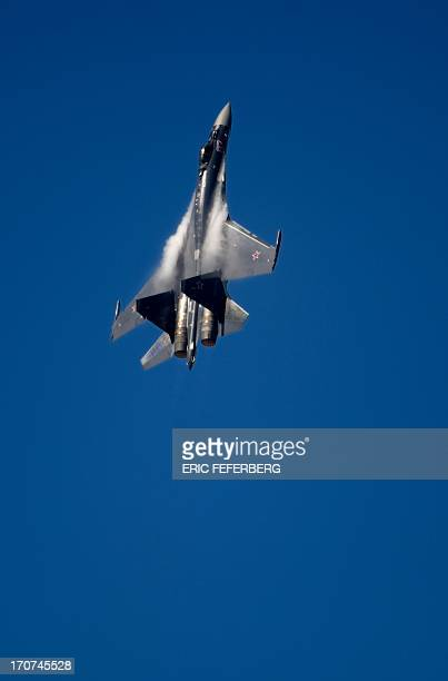 A Russian Sukhoi 35 flies over Le Bourget airport on June 17 2013 on the opening day of the International Paris Air show AFP PHOTO / ERIC FEFERBERG