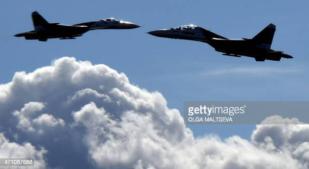 Russian Sukhoi Su27 jet fighters perform during an air show in St Petersburg on April 25 2015 AFP PHOTO / OLGA MALTSEVA