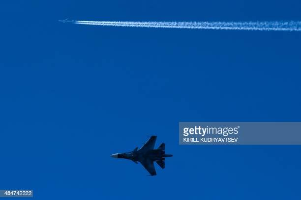 A Russian Sukhoi Su33 singleseat shipbased STOBAR fighter performs on rehearsal day for the MAKS2015 the International Aviation and Space Show in...