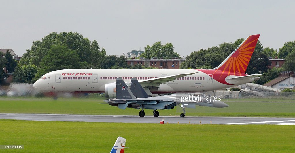A Russian Sukhoi SU-35 fighter jet takes off in front of the Air India Boeing 787 Dreamliner to present its flying display at Le Bourget airport, near Paris on June 20, 2013 during the 50th International Paris Air show.