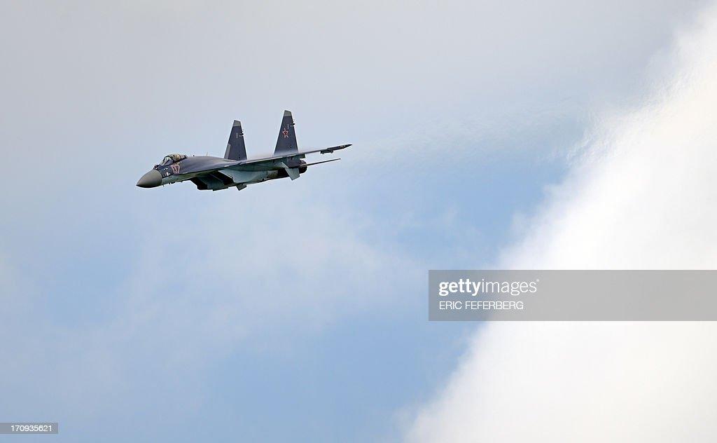 A Russian Sukhoi SU-35 flies over Le Bourget airport, near Paris on June 20, 2013 during the 50th International Paris Air show.