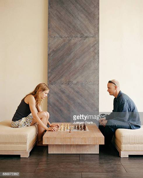 Russian supermodel Natalia Vodianova playing chess with her husband British artist Justin Portman inside their New York City home