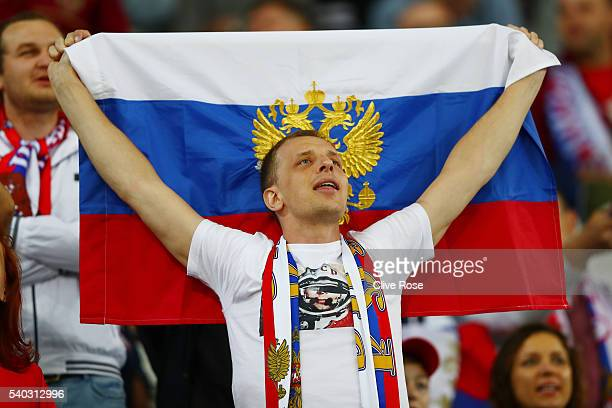 Russian supporter holds p his country's flag during the UEFA EURO 2016 Group B match between Russia and Slovakia at Stade PierreMauroy on June 15...
