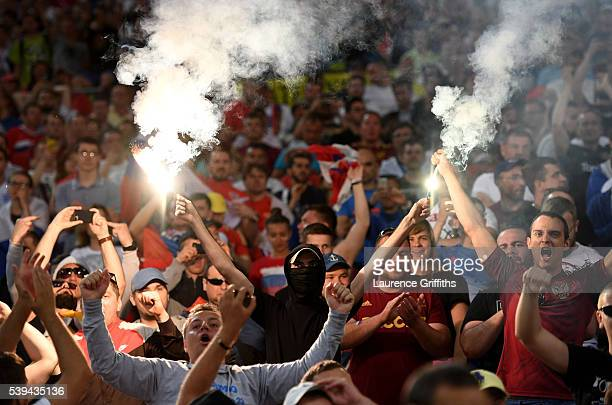 Russian supporter liggt fireworks during the UEFA EURO 2016 Group B match between England and Russia at Stade Velodrome on June 11 2016 in Marseille...