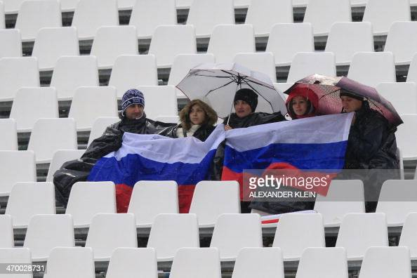 Russian supporters attend the Women's Alpine Skiing Giant Slalom Run 2 at the Rosa Khutor Alpine Center during the Sochi Winter Olympics on February...