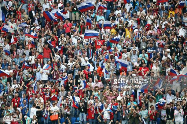 Russian supporters cheer during the FIFA Confederations Cup Russia 2017 Group A match between Russia and New Zealand at Saint Petersburg Stadium on...