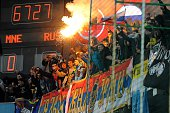 Russian supporters light a flare during the Euro 2016 qualifying football match between Montenegro and Russia at the City stadium in Podgorica on...