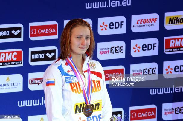 Russian swimmer Veronika Popova cries as she stands on the podium after winning the women's 100 M freestyle final at the European Swimming...
