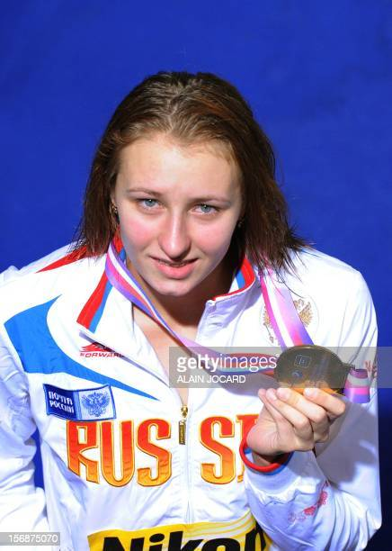 Russian swimmer Veronika Popova holds her gold medal as she poses on the podium after winning the women's 100 M freestyle final at the European...
