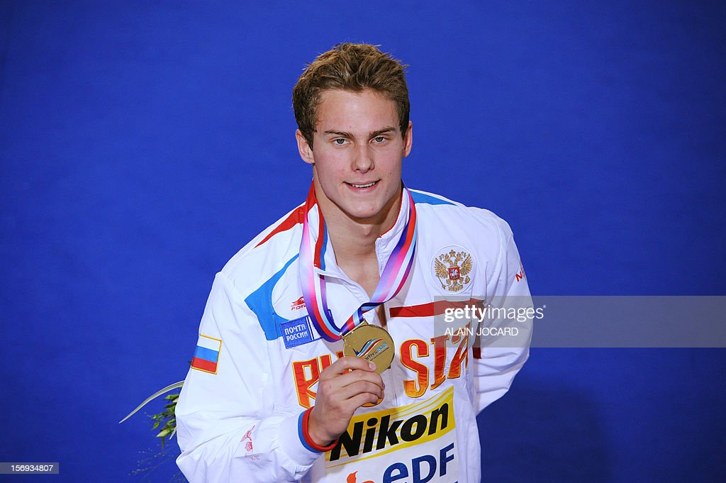 Russian swimmer Vladimir Morozov poses with the gold medal after winning the men's short course 100 m individual medley final at the European Swimming Championships on November 25, 2012, in Chartres.