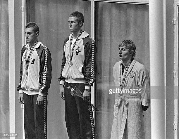 Russian Swimmer Vladimir Salnikov Gold medalist in the1500m freestyle category stands on the podium in between his compatriot Aleksandr Chaef who won...