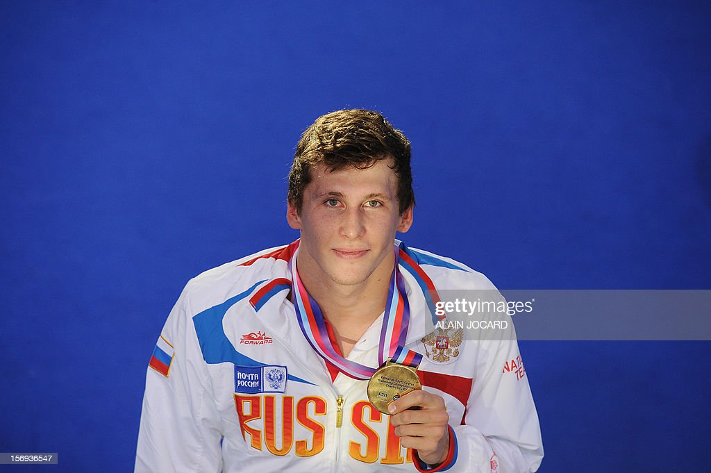 Russian swimmer Vyacheslav Sinkevich poses with his gold medal after winning the men's 200 m breastroke final at the European short course swimming championships, on November 25, 2012, in Chartres. AFP PHOTO/ ALAIN JOCARD