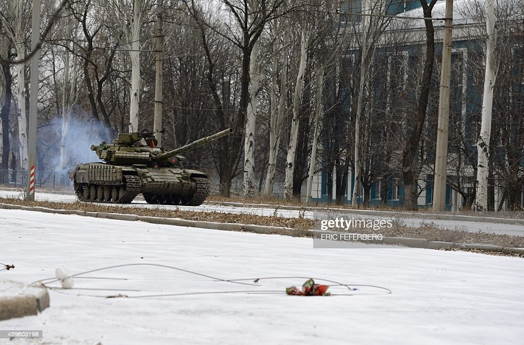 A Russian T72 tank without a license plate and coming from Donetsk airport area moves along a snowcovered avenue in the district of Kievsky in...