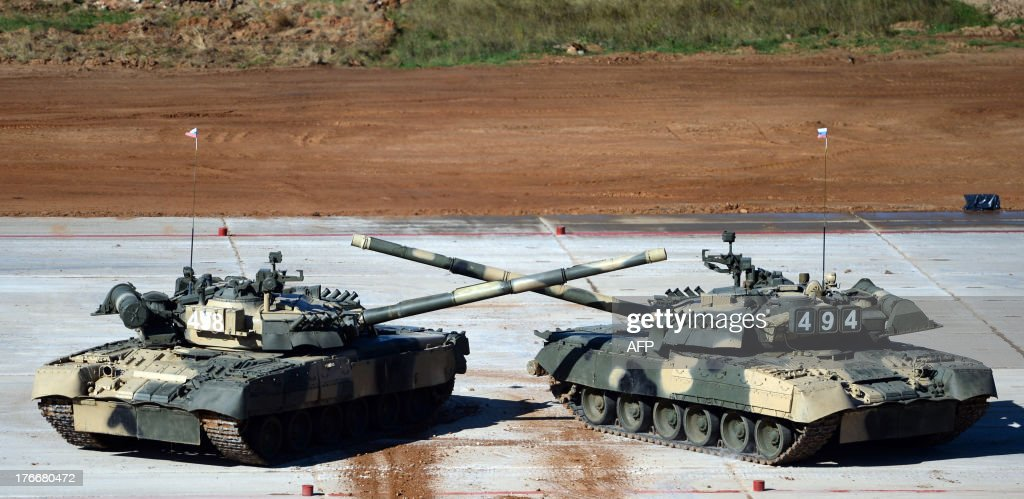 Russian tank drivers demonstrate their skill before the start of tank biathlon, a new paramilitary international sport competition about armor races and precision gunnery near Alabino, outside Moscow, on August 17, 2013.