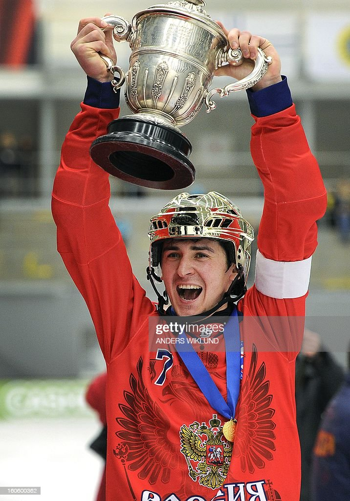 Russian team captain Sergei Lomanov raises the trophy after as they celebrate their 4-3 victory in the Bandy World Championship final match Sweden vs Russia in Vanersborg, Sweden, February 3, 2013.