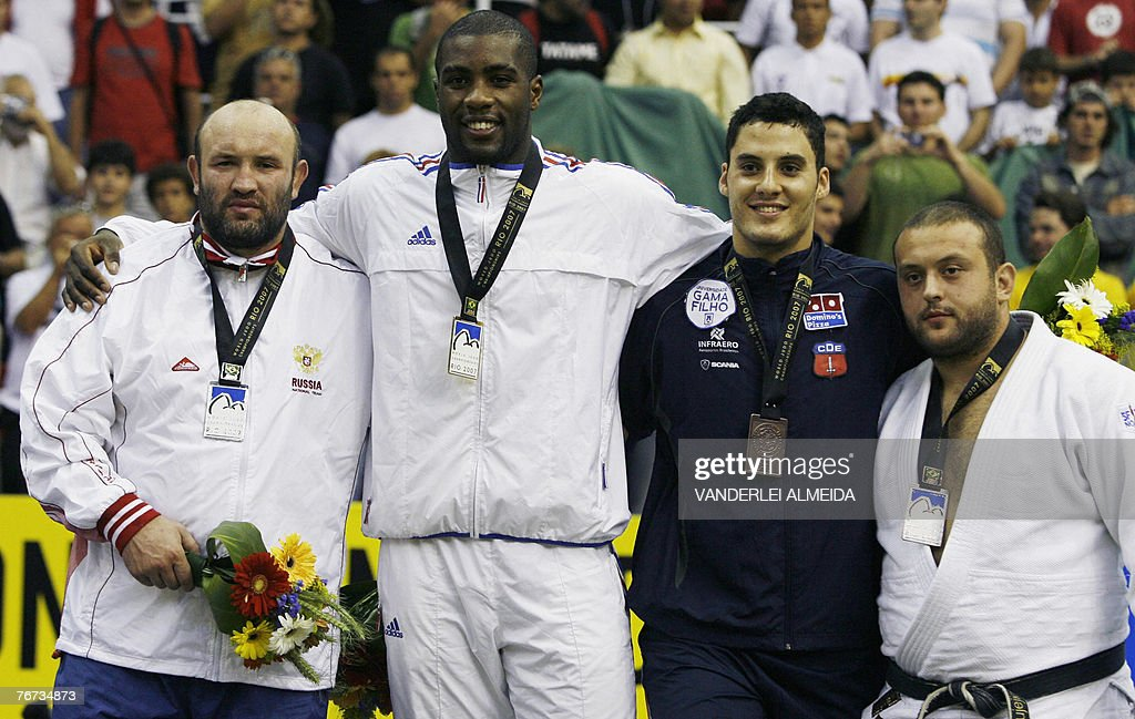 Russian Temerian Tmenov (silver medal), France's <a gi-track='captionPersonalityLinkClicked' href=/galleries/search?phrase=Teddy+Riner&family=editorial&specificpeople=4114927 ng-click='$event.stopPropagation()'>Teddy Riner</a> (gold Medal), Brazilian Joao Schlittler (bronze medal) and Georgia Lasha Guyejiani (bronze medal) celebrate on the podium after the men's + 100kg category final at the 25th World Judo Championship in Rio de Janeiro, 13 September 2007. AFP PHOTO/VANDERLEI ALMEIDA
