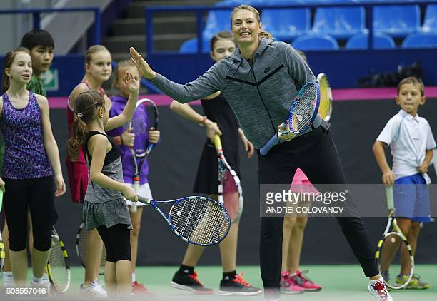TOPSHOT Russian tennis player Maria Sharapova gives a tennis master class for children in Moscow on February 5 2016 Russia will face the Netherlands...