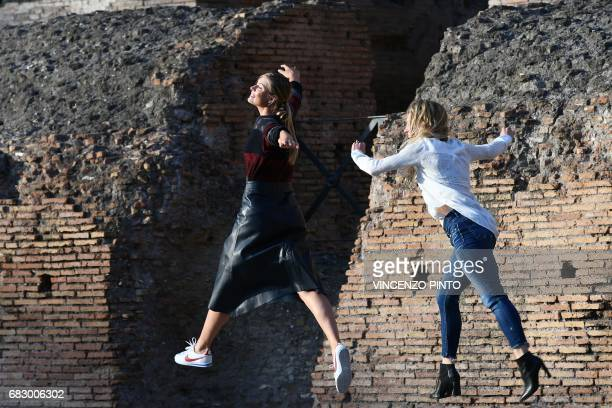 Russian tennis player Maria Sharapova jokes with an assistant at the Colosseum on May 14 2017 in Rome Fivetime Grand Slam champion Maria Sharapova...