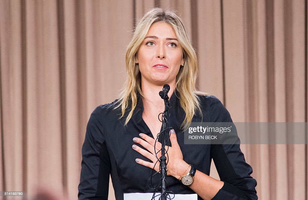 TOPSHOT - Russian tennis player Maria Sharapova speaks at a press conference in downtown Los Angeles, California, March 7, 2016. The former world number one announced she failed a doping test at the Australian Open, saying a change in the World-Anti-Doping Agency banned list led to the violation. Sharapova said she tested positive for Meldonium, a substance she had been taking since 2006 but one that was added to the banned list this year. / AFP / ROBYN