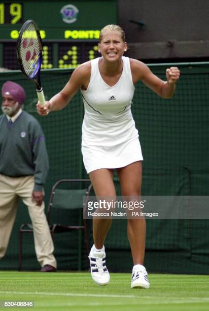 Russian tennis star Anna Kournikova celebrates her 7/5 5/7 6/4 victory over Sandrine Testud of France during the first day of the Lawn Tennis...