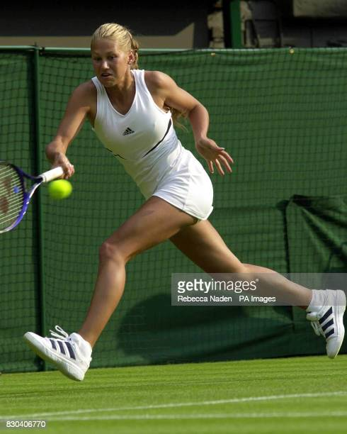 Russian tennis star Anna Kournikova in action against Sandrine Testud of France during the first day of the Lawn Tennis Championships at Wimbledon
