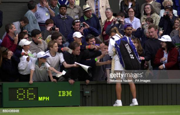 Russian tennis star Anna Kournikova signs autographs after her 7/5 5/7 6/4 victory over Sandrine Testud of France during the first day of the Lawn...