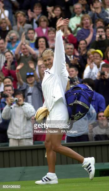 Russian tennis star Anna Kournikova waves to crowed after her 7/5 5/7 6/4 victory over Sandrine Testud of France during the first day of the Lawn...