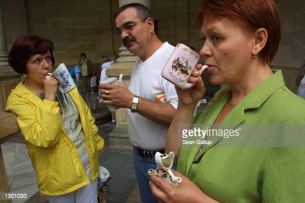 Russian tourists from Siberia sip mineralrich water fresh from a spring August 7 2002 in the spa town of Karlovy Vary Czech Republic Karlovy Vary...