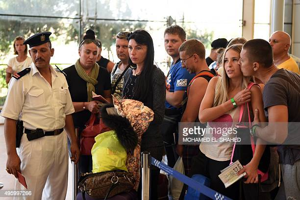 Russian tourists queue at the airport in Egypt's Red Sea resort of Sharm ElSheikh on November 6 2015 Egypt is not allowing British airlines to fly...