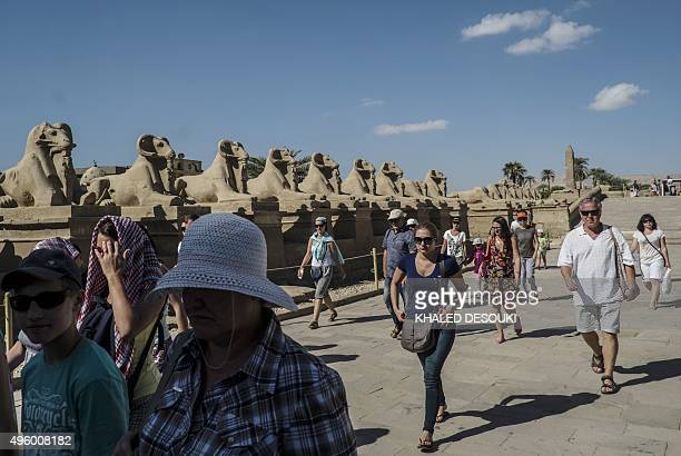 Russian tourists visit the famed Karnak temple one of Egypt's most popular heritage attractions in the southern city of Luxor on November 6 2015...