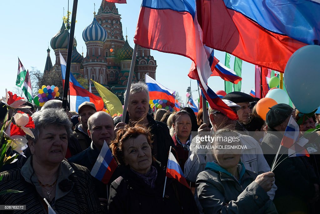 Russian Trade Unions' members holding flags parade on Red Square in Moscow on May 1, 2016, during their May Day demonstration. / AFP / NATALIA