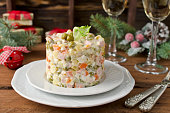 Russian traditional salad Olivier with vegetables and meat. Winter Christmas salad