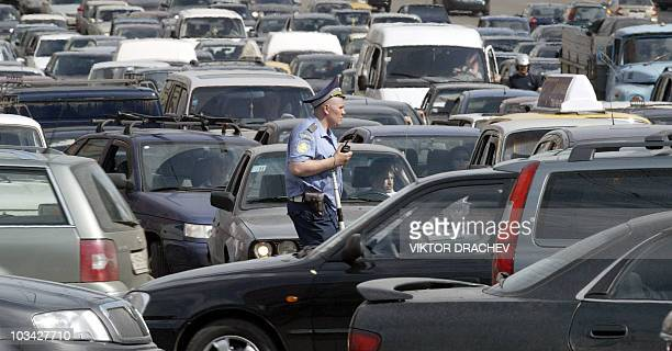 A Russian traffic policeman works in a street with a huge traffic jam in Moscow 25 May 2005 A massive power outage caused chaos in Moscow stranding...