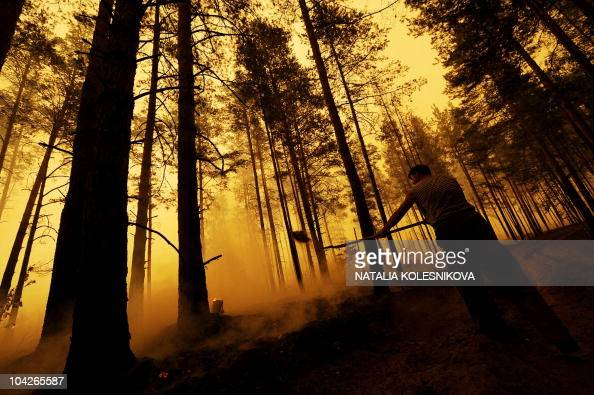 A Russian tries to stop fire near the village of Golovanovo Ryazan region on August 5 2010Russia struggled to contain the worst wildfires in its...