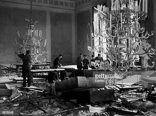 Russian troops in the treaty room at the Chancellery in Berlin where the huge chandeliers hang nearly to the floor