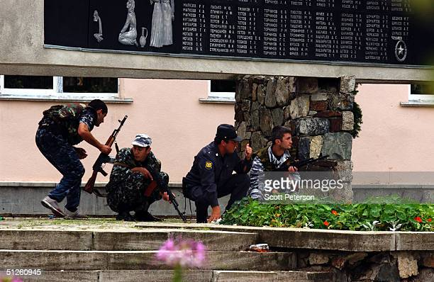 Russian troops stand guard near a school September 3 2004 in Beslan Russia More than 200 people were reportedly killed and at least 700 wounded after...