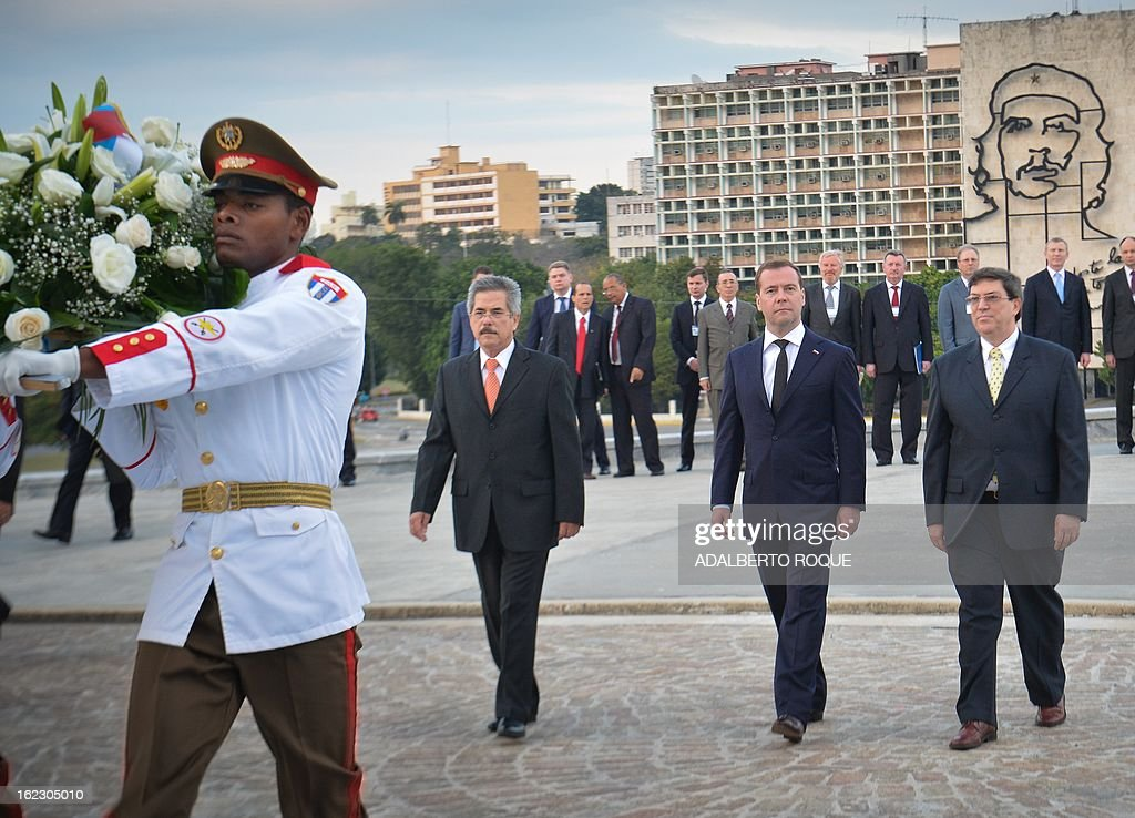 Russian Vice President Dmitri Medvedev (C) during a ceremony at Revolution Square in Havana, on February 21, 2013. Medvedev is in Cuba in a three-day official visit. AFP PHOTO/ADALBERTO ROQUE
