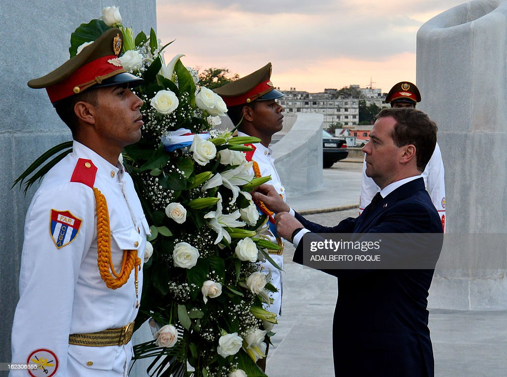Russian Vice President Dmitri Medvedev during a wreath-laying ceremony at Revolution Square in Havana, on February 21, 2013. Medvedev is in Cuba in a three-day official visit. AFP PHOTO/ADALBERTO ROQUE