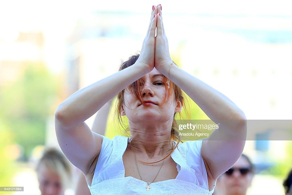 A Russian woman performs yoga exercises during the 2th International Yoga Day Russia at the Park Muzeon in Moscow, Russia, on June 26, 2016.