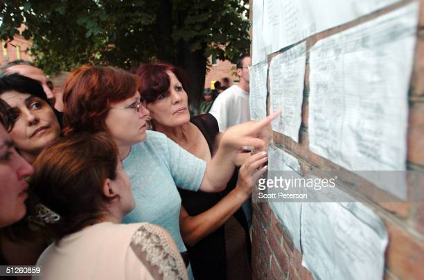 Russian woman view a list outside a hospital September 3 2004 in Beslan Russia More than 200 people were reportedly killed and at least 700 wounded...