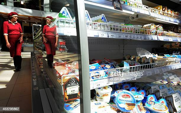 A Russian woman walks past refrigerated foodstuffs at a supermarket in Saint Petersburg on August 7 2014 Russia retaliated against tough new Western...