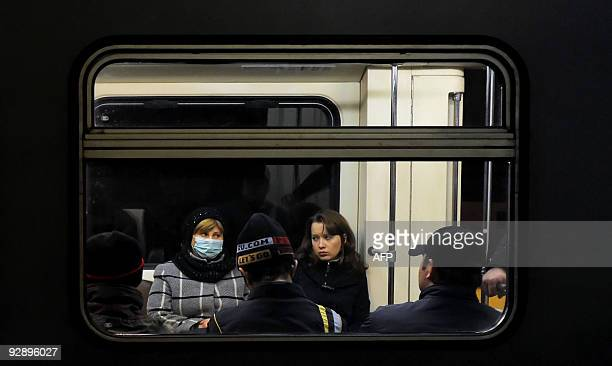 A Russian woman wears a face mask to ward off potential flu viruses in the Moscow metro on November 5 2009 Many Russians are becoming worried as the...