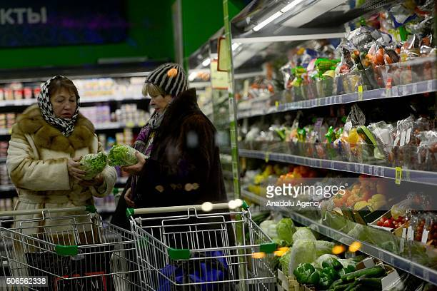 Russian women are seen during shopping after depreciation in Russian Rouble in Moscow Russia on January 24 2016