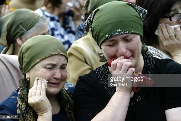 Russian women cry during the funeral of sisters Irina and Alina Tetova September 5 2004 in Beslan Russia The girls were killed after Chechen militant...