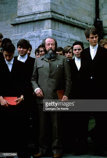 Russian writer Aleksandr Solzhenitsyn with pupils during a visit to Eton College May 1983
